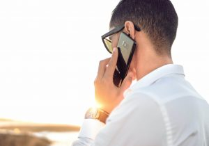 Person takes a call on a mobile phone while outside